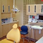 Dentist examination room with a yellow chair