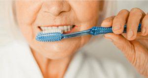 Old Lady Brushing Teeth